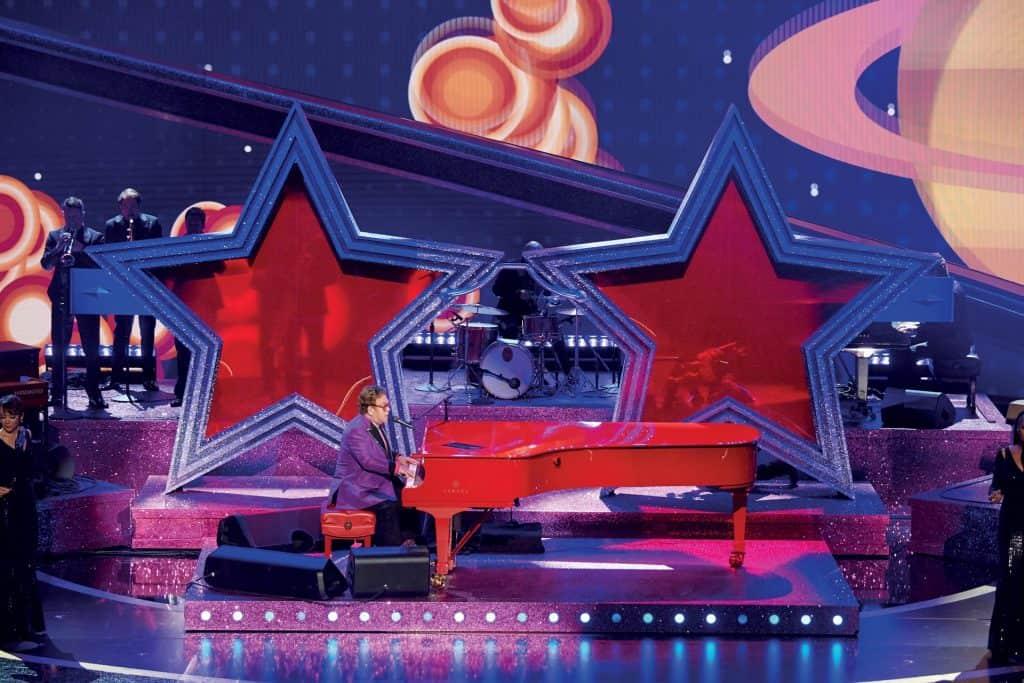 This is photo of a Elton John singing